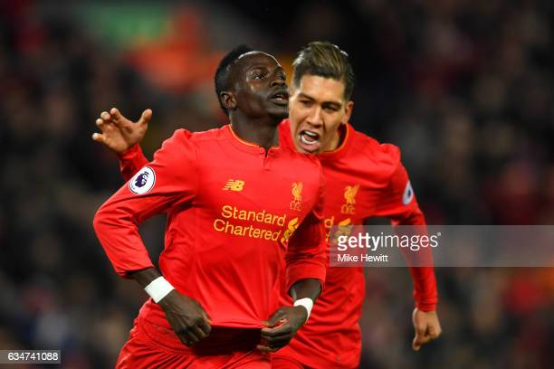Sadio Mane of Liverpool celebrates scoring the oprning goal with his team mate Roberto Firmino during the Premier League match between Liverpool and...