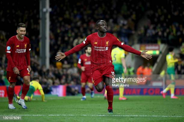 Sadio Mane of Liverpool celebrates scoring the winning goal during the Premier League match between Norwich City and Liverpool FC at Carrow Road on...