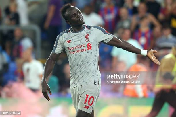 Sadio Mane of Liverpool celebrates scoring their 2nd goal by drumming up support from the crowd during the Premier League match between Crystal...