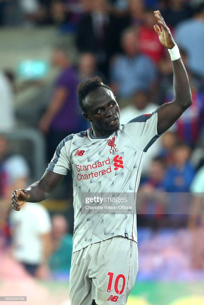 Sadio Mane of Liverpool celebrates scoring their 2nd goal by drumming up support from the crowd during the Premier League match between Crystal Palace and Liverpool FC at Selhurst Park on August 20, 2018 in London, United Kingdom.