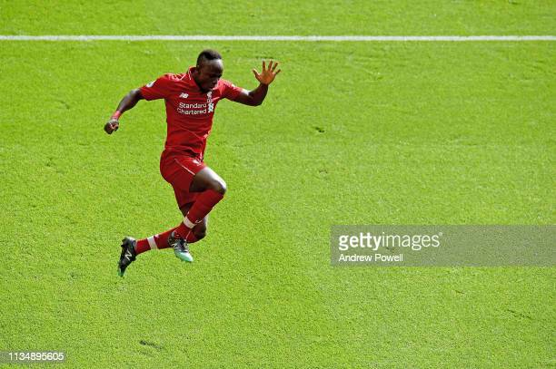Sadio Mane of Liverpool celebrates the second goal during the Premier League match between Liverpool FC and Burnley FC at Anfield on March 10 2019 in...