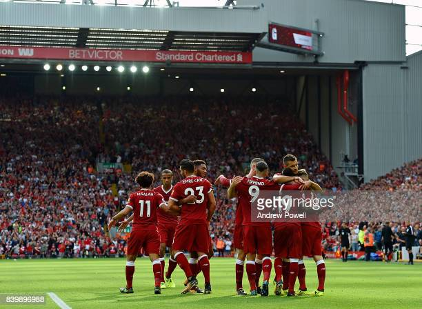 Sadio Mane of Liverpool celebrates the second goal during the Premier League match between Liverpool and Arsenal at Anfield on August 27 2017 in...