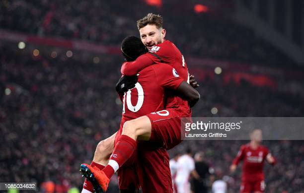 Sadio Mane of Liverpool celebrates with Adam Lallana after scoring his sides fourth goal during the Premier League match between Liverpool FC and...