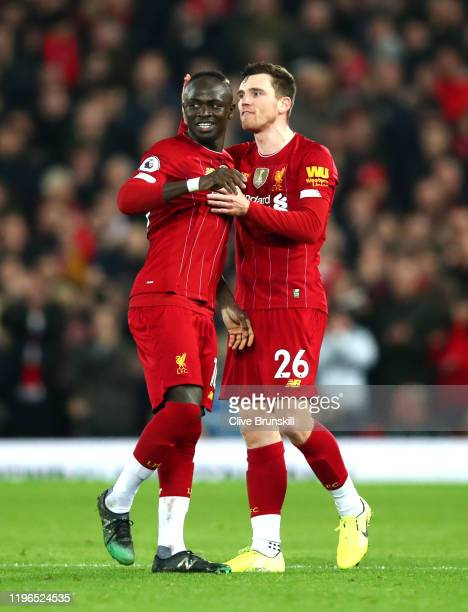 Sadio Mane of Liverpool celebrates with Andy Robertson of Liverpool after scoring his sides first goal during the Premier League match between...