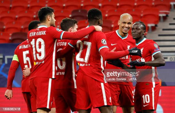 Sadio Mane of Liverpool celebrates with Fabinho and team mates after scoring their side's second goal during the UEFA Champions League Round of 16...
