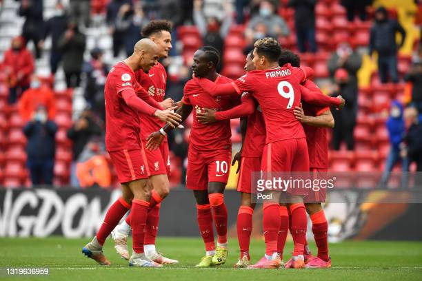 Sadio Mane of Liverpool celebrates with Fabinho and team mates after scoring their side's second goal during the Premier League match between...