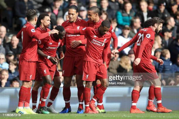 Sadio Mane of Liverpool celebrates with his team after he scores his sides first goal during the Premier League match between Fulham FC and Liverpool...