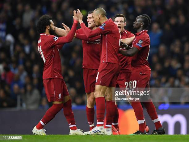 Sadio Mane of Liverpool celebrates with his teammates after scoring his team's first goal during the UEFA Champions League Quarter Final second leg...