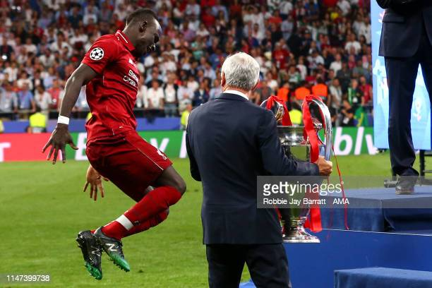 Sadio Mane of Liverpool celebrates with Ian Rush as he carries out the UEFA Champions League trophy during the UEFA Champions League Final between...