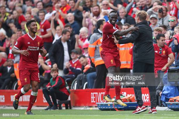 Sadio Mane of Liverpool celebrates with Jurgen Klopp manager / head coach of Liverpool after scoring a goal to make it 10 during the Premier League...