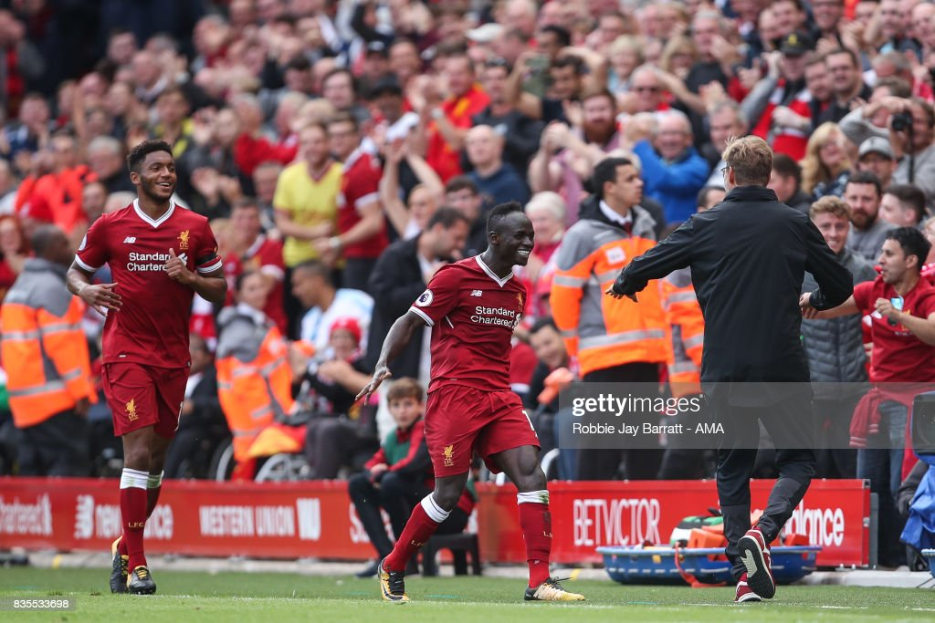 Sadio Mane of Liverpool celebrates with Jurgen Klopp manager / head coach of Liverpool after scoring a goal to make it 1-0 during the Premier League match between Liverpool and Crystal Palace at Anfield on August 19, 2017 in Liverpool, England.