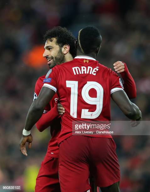 Sadio Mane of Liverpool celebrates with Mohamed Salah after scoring their third goal during the UEFA Champions League Semi Final First Leg match...