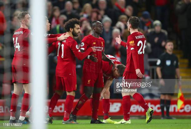 Sadio Mane of Liverpool celebrates with Mohamed Salah and Andy Robertson after scoring his team's second goal during the Premier League match between...