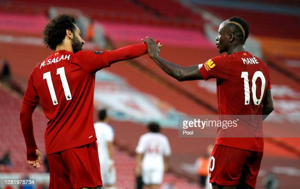 Sadio Mane of Liverpool celebrates with Mohamed Salah of Liverpool after scoring his sides fourth goal during the Premier League match between...