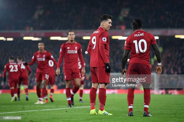 Sadio Mane of Liverpool celebrates with Roberto Firmino after scoring his sides fourth goal during the Premier League match between Liverpool FC and...