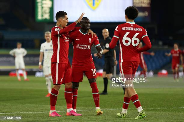 Sadio Mane of Liverpool celebrates with Roberto Firmino and Trent Alexander-Arnold after scoring his team's first goal during the Premier League...