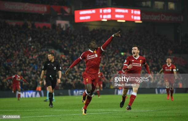 Sadio Mane of Liverpool celebrates with team mate Andy Robertson after scoring the third Liverpool goal during during the Premier League match...