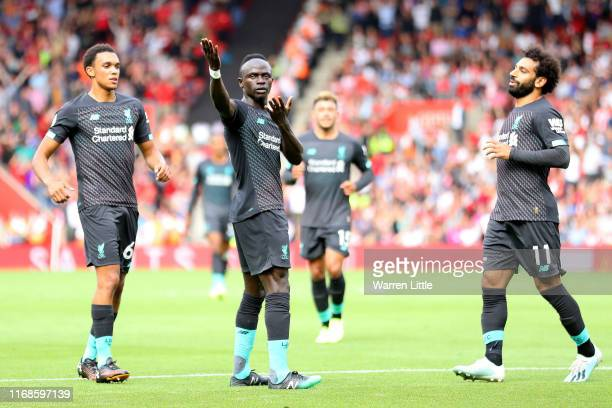 Sadio Mane of Liverpool celebrates with team mates after scoring his team's first goal during the Premier League match between Southampton FC and...