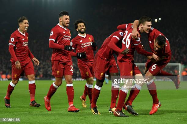 Sadio Mane of Liverpool celebrates with team mates after scoring the third Liverpool goal during the Premier League match between Liverpool and...