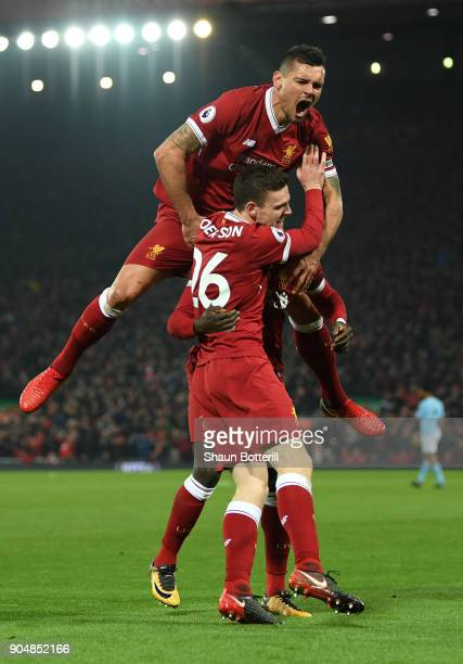 Sadio Mane of Liverpool celebrates with team mates Andy Robertson and Dejan Lovren after scoring the third Liverpool goal during the Premier League...