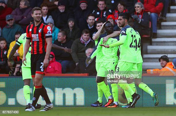Sadio Mane of Liverpool celebrates with team mates as he scores their first goal during the Premier League match between AFC Bournemouth and...
