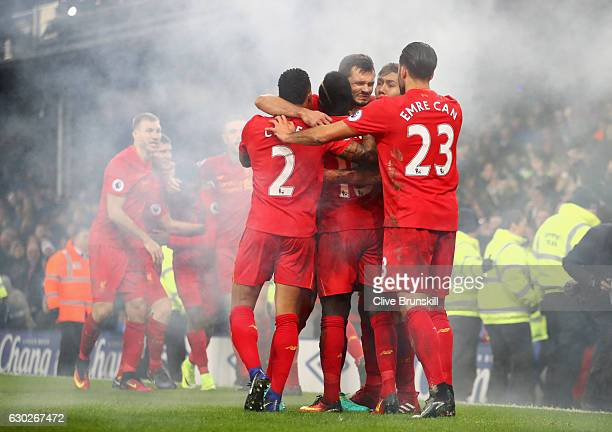 Sadio Mane of Liverpool celebrates with team mates as he scores their first goal during the Premier League match between Everton and Liverpool at...