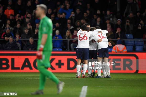 Sadio Mane of Liverpool celebrates with teammate after scoring his team's first goal during the Premier League match between Crystal Palace and...