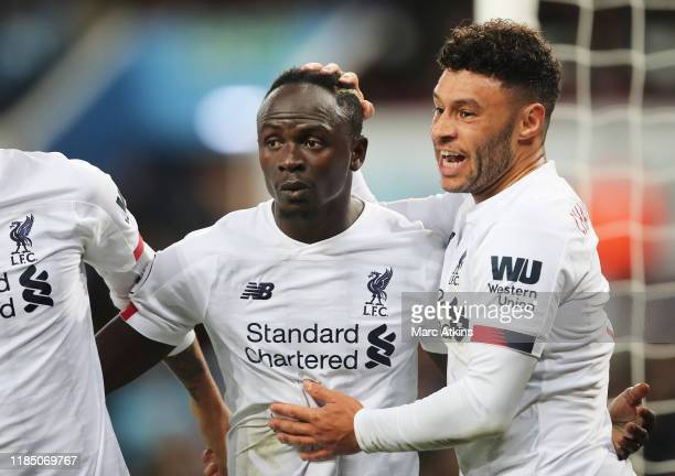 Sadio Mane of Liverpool celebrates with teammate Alex OxladeChamberlain after scoring his team's second goal during the Premier League match between...