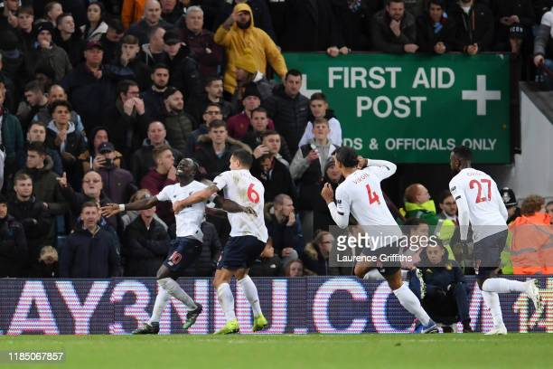 Sadio Mane of Liverpool celebrates with teammate Dejan Lovren after scoring his team's second goal during the Premier League match between Aston...