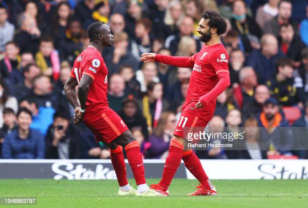 Sadio Mane of Liverpool celebrates with teammate Mohamed Salah after scoring their side's first goal during the Premier League match between Watford...
