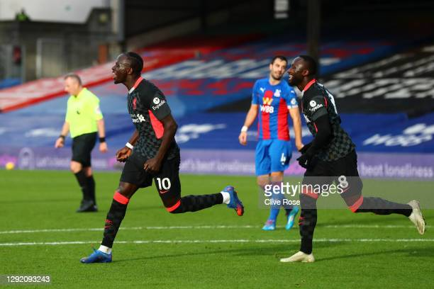 Sadio Mane of Liverpool celebrates with teammate Naby Keita after scoring their sides second goal during the Premier League match between Crystal...