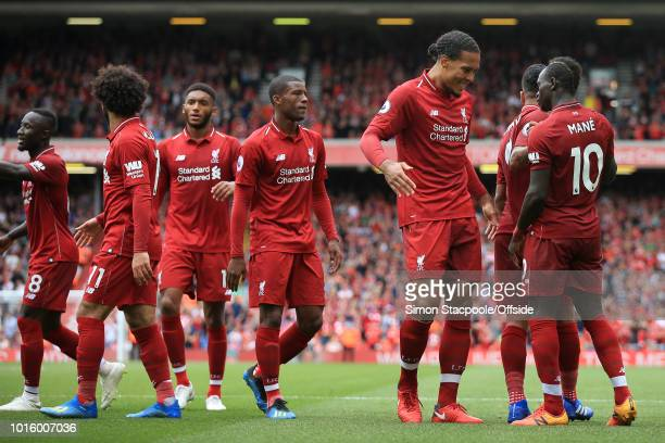 Sadio Mane of Liverpool celebrates with teammate Virgil van Dijk of Liverpool after scoring their 2nd goal during the Premier League match between...