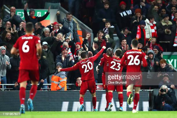 Sadio Mane of Liverpool celebrates with teammate Xherdan Shaqiri after scoring his team's fourth goal during the Premier League match between...