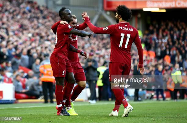 Sadio Mane of Liverpool celebrates with teammates after scoring his team's fourth goal during the Premier League match between Liverpool FC and...