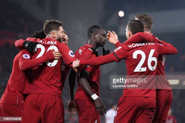 Sadio Mane of Liverpool celebrates with teammates after scoring his sides fourth goal during the Premier League match between Liverpool FC and...