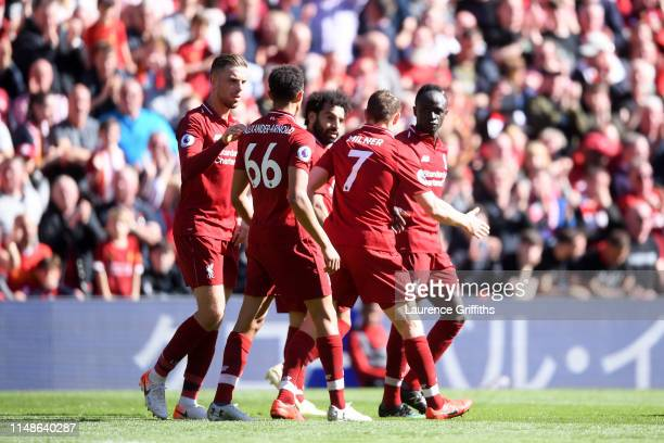 Sadio Mane of Liverpool celebrates with teammates after scoring his team's second goal during the Premier League match between Liverpool FC and...
