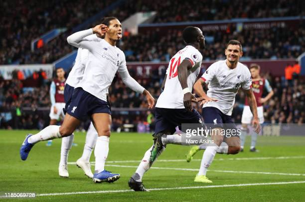 Sadio Mane of Liverpool celebrates with teammates after scoring his team's second goal during the Premier League match between Aston Villa and...