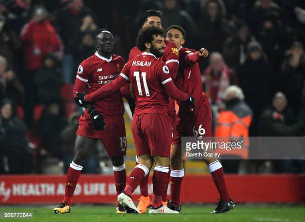 Sadio Mane of Liverpool celebrates with teammates after scoring his sides second goal during the Premier League match between Liverpool and Newcastle...