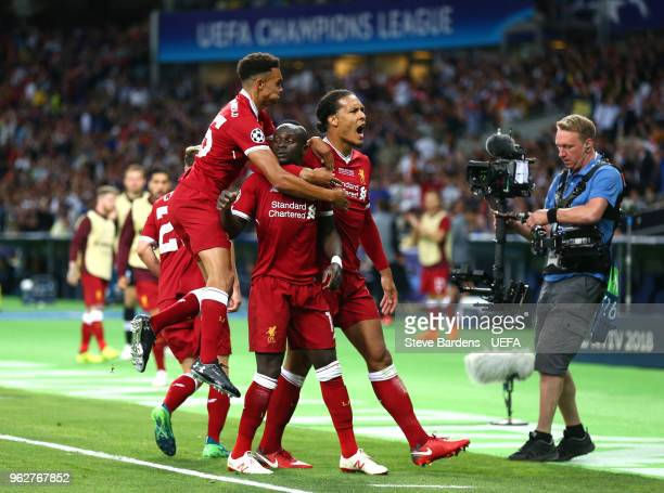 Sadio Mane of Liverpool celebrates with teammates after scoring his sides first goal during the UEFA Champions League Final between Real Madrid and...