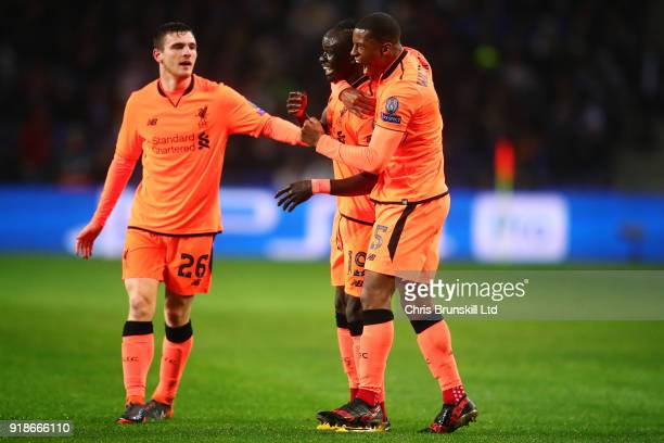 Sadio Mane of Liverpool celebrates with teammates Georginio Wijnaldum and Andrew Robertson after scoring the opening goal during the UEFA Champions...