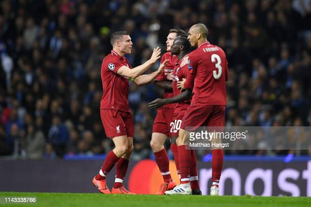 Sadio Mane of Liverpool celebrates with teammates James Milner Andy Robertson and Fabinho of Liverpool after scoring his team's first goal during the...