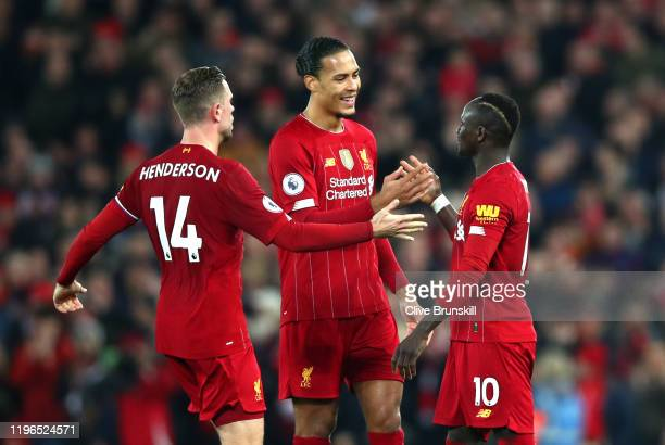 Sadio Mane of Liverpool celebrates with Virgil van Dijk of Liverpool and Jordan Henderson of Liverpool after scoring his sides first goal during the...