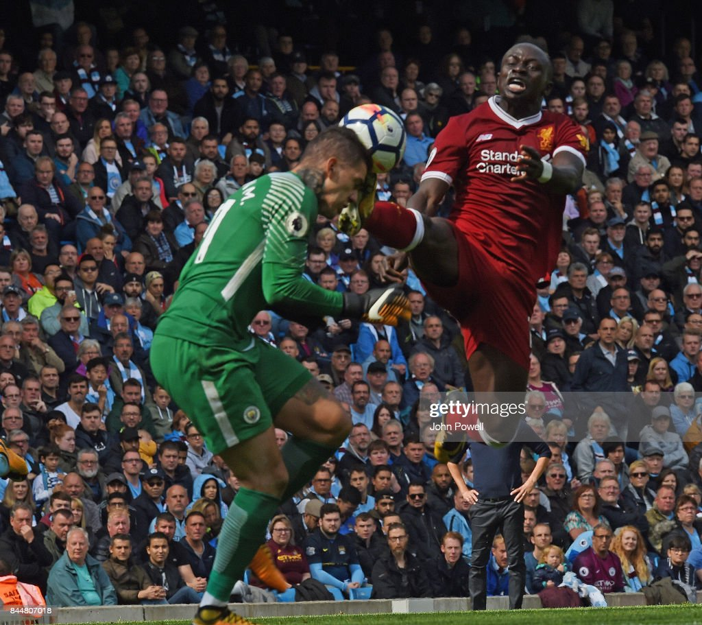 Sadio Mane of Liverpool Challenges Ederson Moraes of Man City and gets sent off during the Premier League match between Manchester City and Liverpool at Etihad Stadium on September 9, 2017 in Manchester, England.