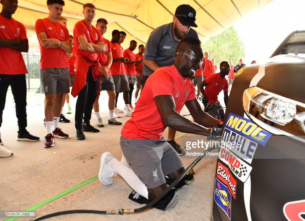 Sadio Mane of Liverpool changing tyres during a tour of Roush Fenway Racing on July 21 2018 in Charlotte North Carolina
