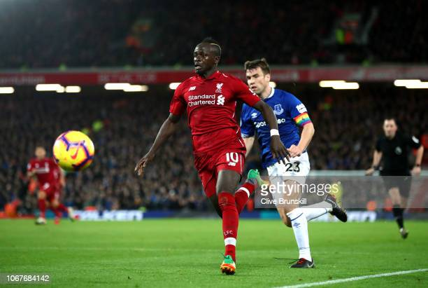 Sadio Mane of Liverpool chases the ball under pressure from Seamus Coleman of Everton during the Premier League match between Liverpool FC and...