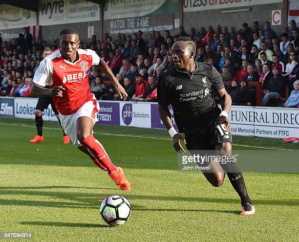 Sadio Mane of Liverpool competes with Akil Wright of Fleetwood Town during the PreSeason Friendly match bewteen Fleetwood Town and Liverpool at...