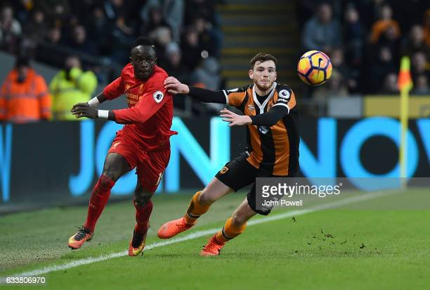 Sadio Mane of Liverpool competes with Andy Robertson of Hull City during the Premier League match between Hull City and Liverpool at KCOM Stadium on...