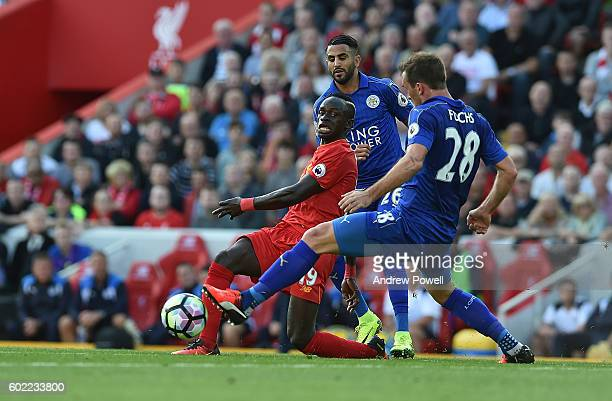Sadio Mane of Liverpool competes with Christisn Fuchs of Leicester City during the Premier League match between Liverpool and Leicester City at...