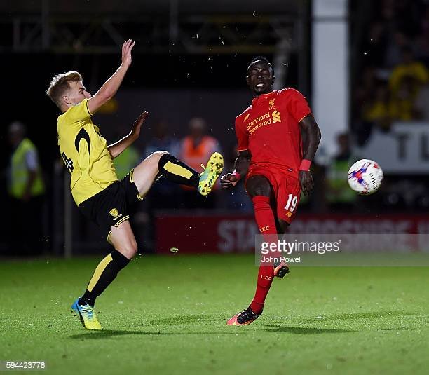 Sadio Mane of Liverpool competes with Damien McCrory of Burton Albionduring the EFL Cup match between Burton Albion and Liverpool at the Pirelli...