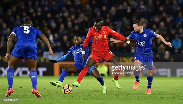 Sadio Mane of Liverpool competes with Danny Drinkwater and Nampalys Mendy of Leicester City during the Premier League match between Leicester City...